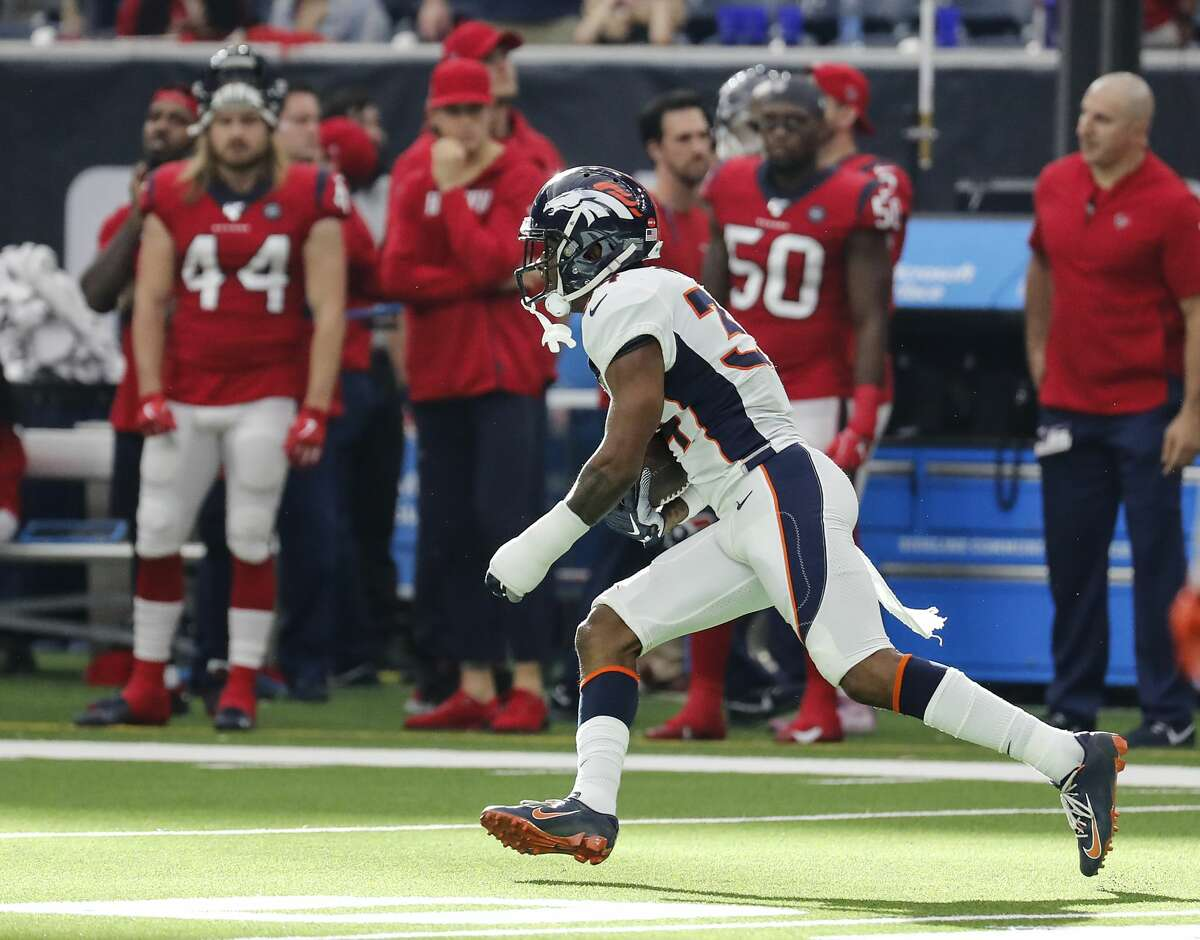 Denver Broncos strong safety Will Parks (34) intercepts a pass thrown by Houston Texans quarterback Deshaun Watson (4) during the fourth quarter of an NFL football game at NRG Stadium on Sunday, Dec. 8, 2019, in Houston.