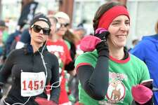 New Haven, Connecticut - Sunday, December 8, 2019: Christopher Martin?•s Christmas Run for Children 5K Sunday in New Haven celebrates its 35th anniversary Sunday with a crowd of approximately 2,000 people. In the 30-year history race, the event has collected over 60,000 donated toys to needy children in the New Haven area during the holiday season. In 2019 the event expects donations of over 2,000 toys for the Southern Connecticut State University and New Haven Police DepartmentToy Drive.