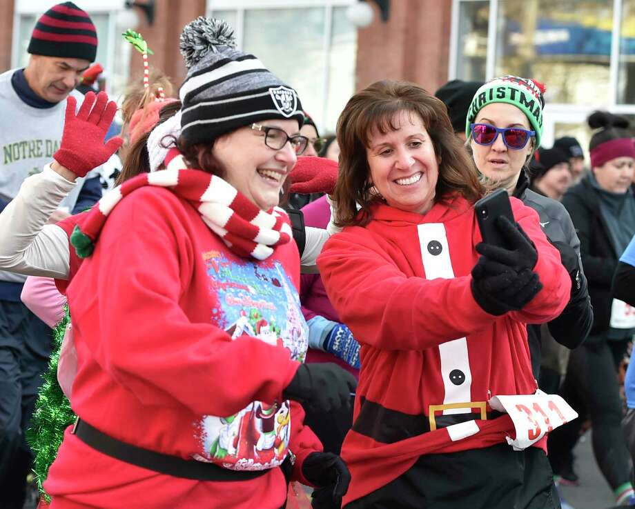 New Haven, Connecticut - Sunday, December 8, 2019:   Christopher MartinÕs Christmas Run for Children 5K Sunday in New Haven celebrates its 35th anniversary Sunday with a crowd of approximately 2,000 people. In the 30-year history race, the event has collected over 60,000 donated toys to needy children in the New Haven area during the holiday season. In 2019 the event expects donations of over 2,000 toys for the Southern Connecticut State University and New Haven Police DepartmentToy Drive. Photo: Peter Hvizdak, Hearst Connecticut Media / New Haven Register
