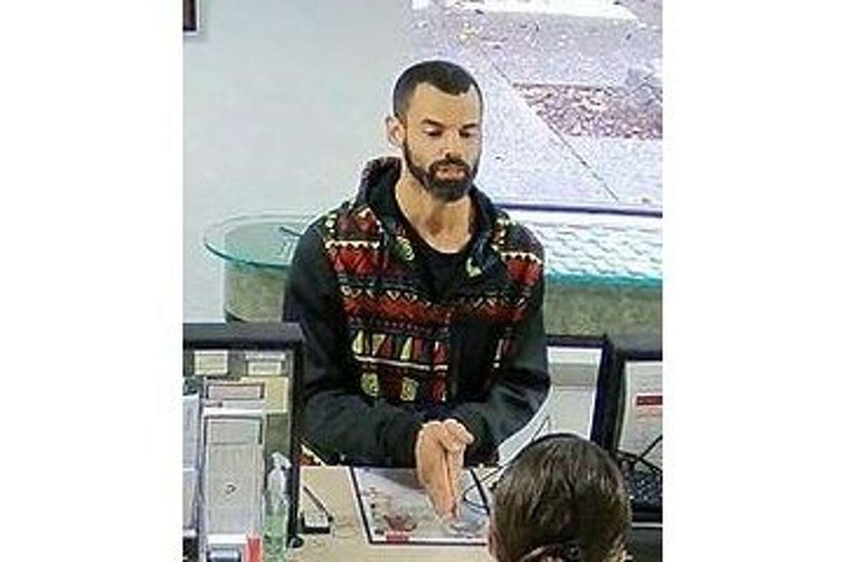 Akili Holmes, a 31-year-old transient arrested and accused of bank robbery, is shown in surveillance video from the Patelco Credit Union in Rohnert Park.