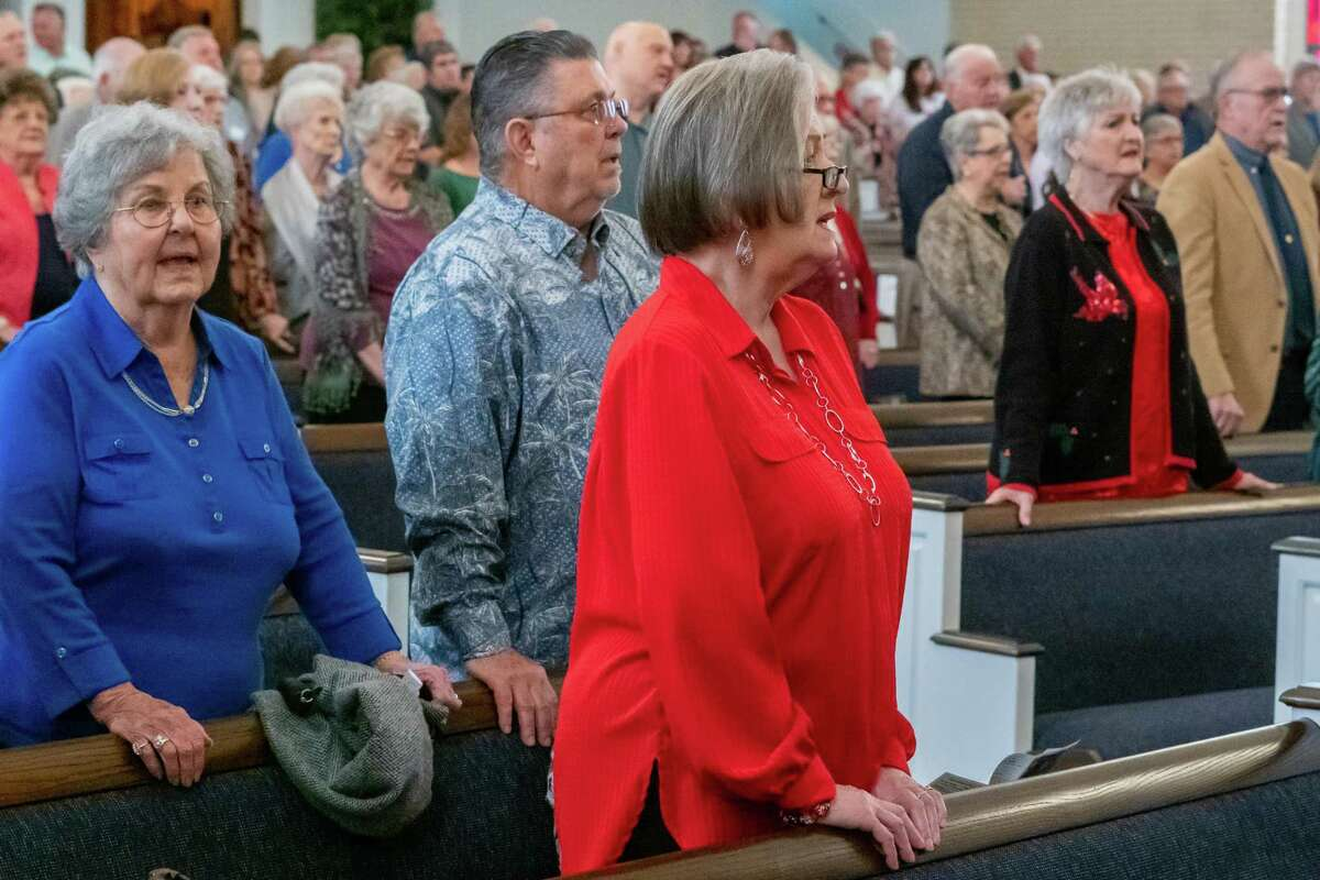 Members of the First Baptist Church of Nederland congregation sing with their friends and neighbors during the service on Sunday, as many of them find solace in their faith in times of crisis like the recent explosion at the TPC plant. Fran Ruchalski/The Enterprise
