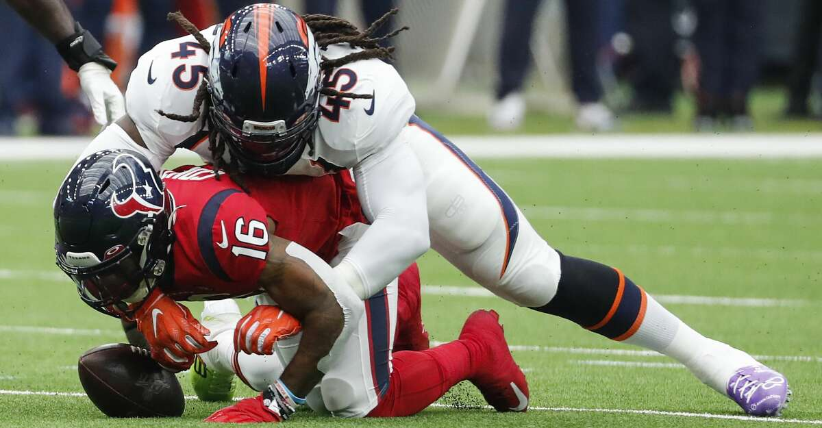 Houston Texans wide receiver Keke Coutee (16) fumbles as he is tackled by Denver Broncos linebacker A.J. Johnson (45) during the first quarter of an NFL football game at NRG Stadium on Sunday, Dec. 8, 2019, in Houston. Broncos strong safety Kareem Jackson picked up the fumble and ran it back for a touchdown.
