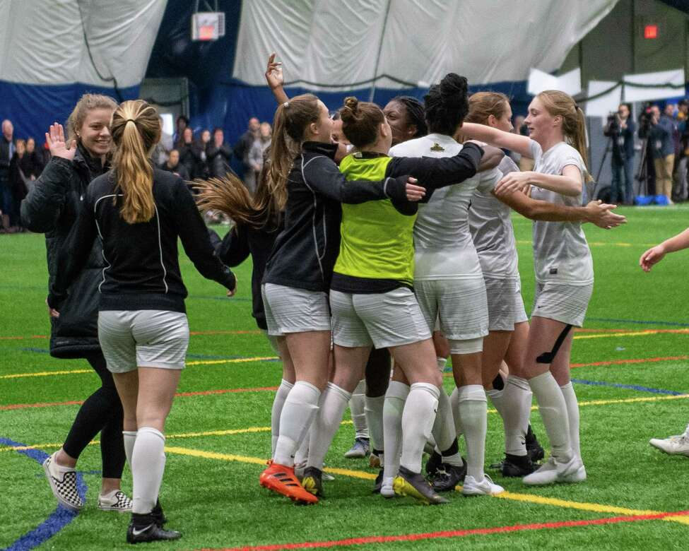 The Saint Rose soccer team celebrates after beating Bloomsburg University in the quarterfinals of the NCAA Division II championship at Afrima€™s Sports Complex in Colonie, New York on Sunday, Dec. 8, 2019. (Jim Franco/Special to the Times Union.)