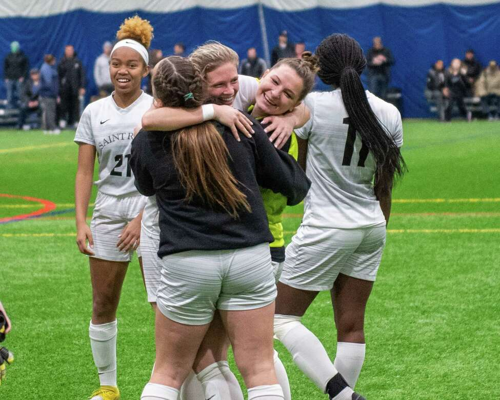 Saint Rose senior Morgan Burchhardt (center) hugs her teammates after beating Bloomsburg University in the quarterfinals of the NCAA Division II championship at Afrima€™s Sports Complex in Colonie, New York on Sunday, Dec. 8, 2019. (Jim Franco/Special to the Times Union.)