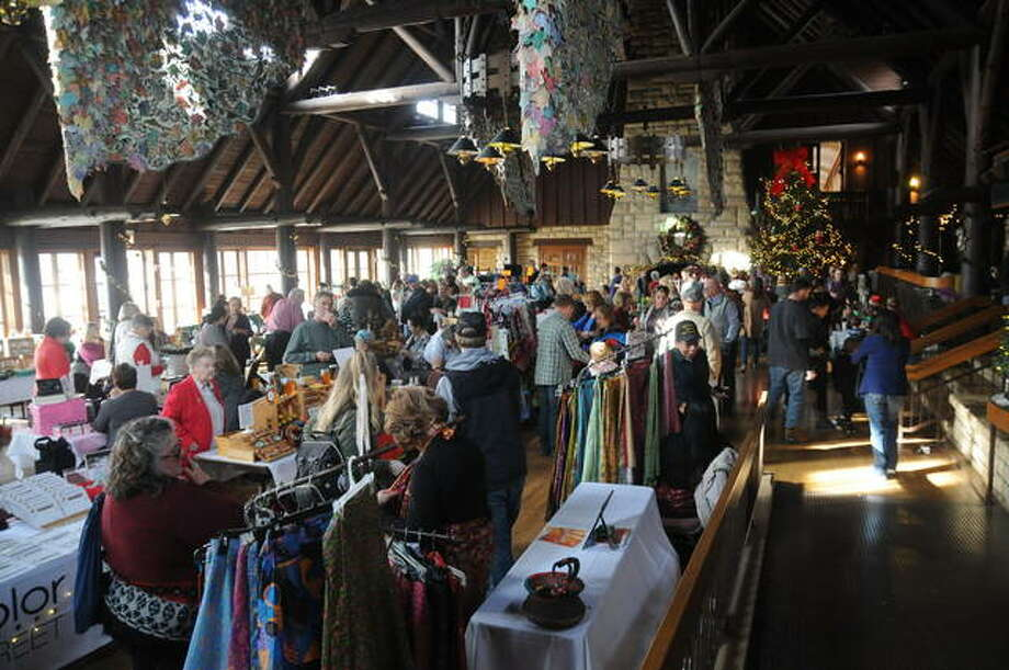 A large crowd of visitors shop Sunday at the inaugural Holiday Festival at the historic Pere Marquette Lodge and Conference Center in Grafton. Photo: David Blanchette For The Telegraph