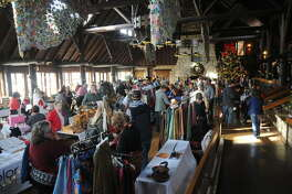 A large crowd of visitors shop Sunday at the inaugural Holiday Festival at the historic Pere Marquette Lodge and Conference Center in Grafton.