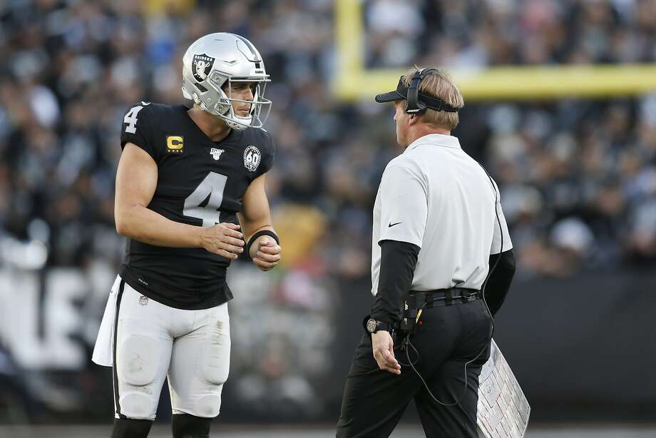 Oakland Raiders quarterback Derek Carr (4) talks with head coach Jon Gruden during the second half of an NFL football game against the Tennessee Titans in Oakland, Calif., Sunday, Dec. 8, 2019. (AP Photo/D. Ross Cameron) Photo: D. Ross Cameron / Associated Press
