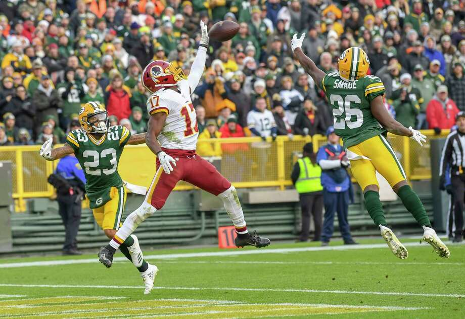Washington Redskins wide receiver Terry McLaurin makes a one-handed touchdown catch against Green Bay Packers defenders Jaire Alexander, left, and free safety Darnell Savage on Sunday, Dec. 8, 2019. Photo: Washington Post Photo By Jonathan Newton / The Washington Post