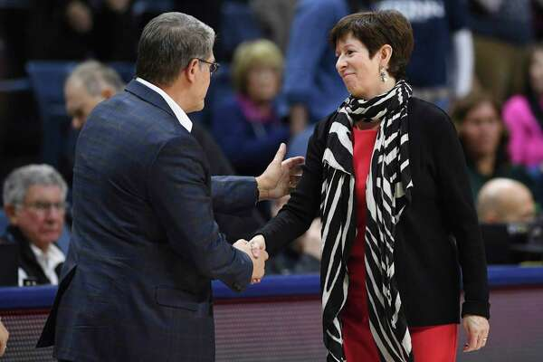 Notre Dame head coach Muffet McGraw, right, shakes hands with UConn coach Geno Auriemma at the end of an NCAA college basketball game, Sunday, Dec. 8, 2019, in Storrs.