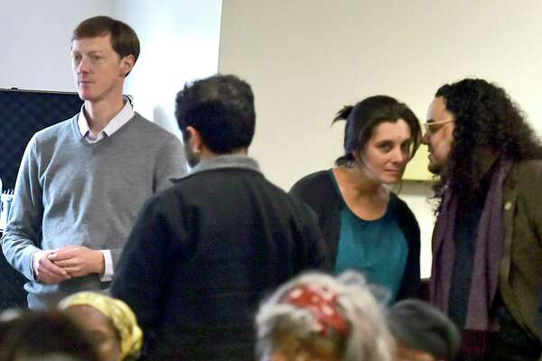 New Haven Mayor-elect Justin Elicker, far left, watches a community meeting for ideas and suggestions on the topics of Economic Development and Education, organized by his transition team, was held Sunday afternoon as the last of a series of meeting held at the High School in the Community in New Haven before Elicker becomes mayor on Jan. 1.
