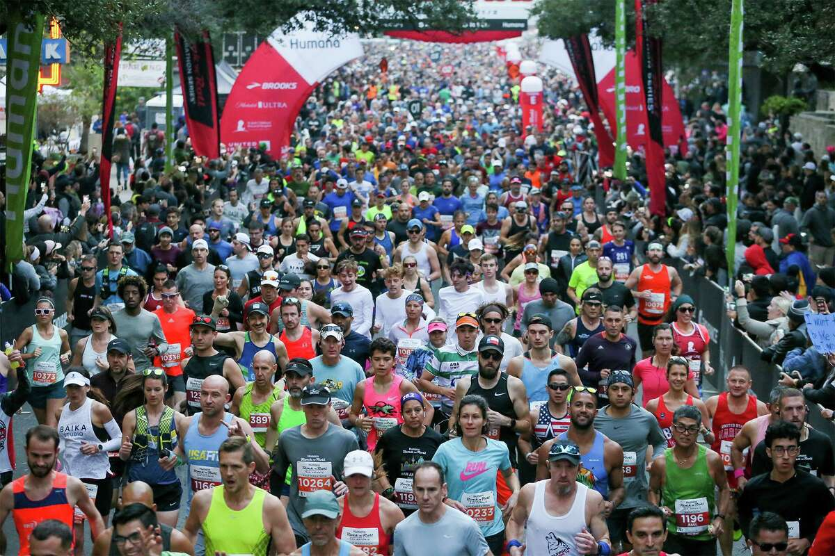 Runners take off from the starting line of the Rock 'n' Roll San Antonio Marathon on West Market Street on Sunday, Dec. 8, 2019.