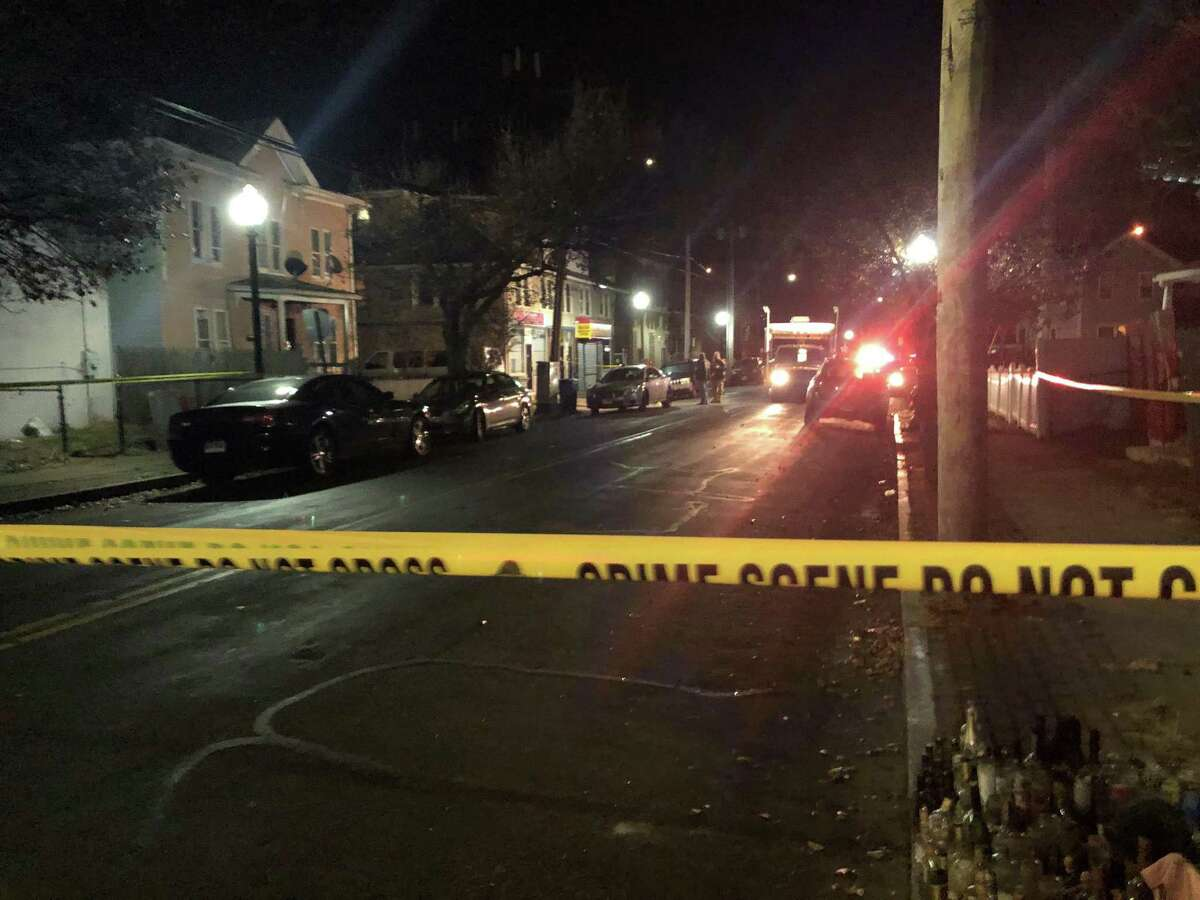 Police investigate the scene of a reported shooting on Newfield Avenue Dec. 8, 2019