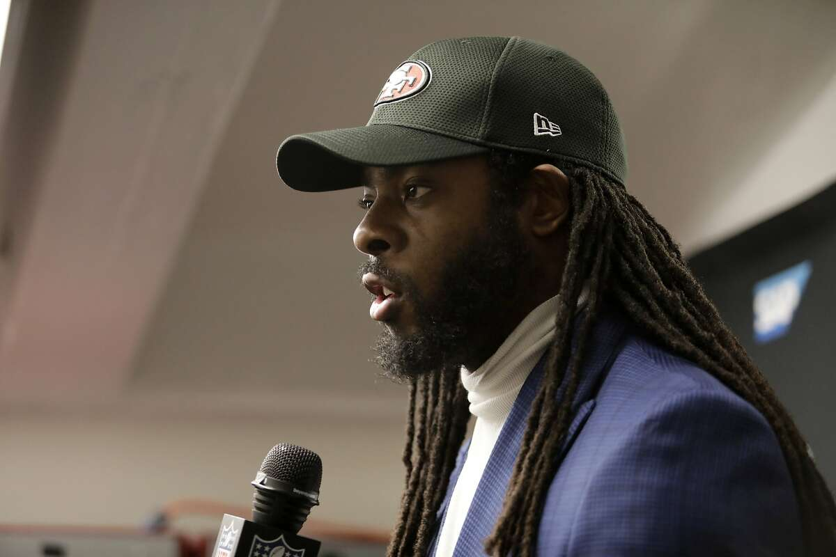 San Francisco 49ers cornerback Richard Sherman talks to reporters after an NFL football game against the New Orleans Saints in New Orleans, Sunday, Dec. 8, 2019. The 49ers won 48-46. (AP Photo/Brett Duke)