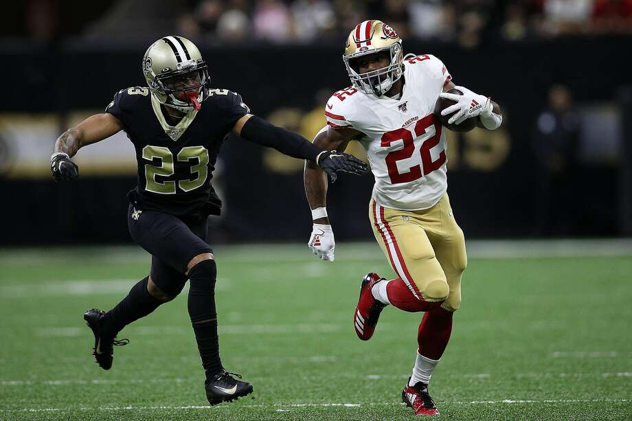 Matt Breida #22 of the San Francisco 49ers avoids a tackle by Marshon Lattimore #23 of the New Orleans Saints at Mercedes Benz Superdome on December 08, 2019 in New Orleans, Louisiana. (Photo by Chris Graythen/Getty Images) Photo: Chris Graythen / Getty Images