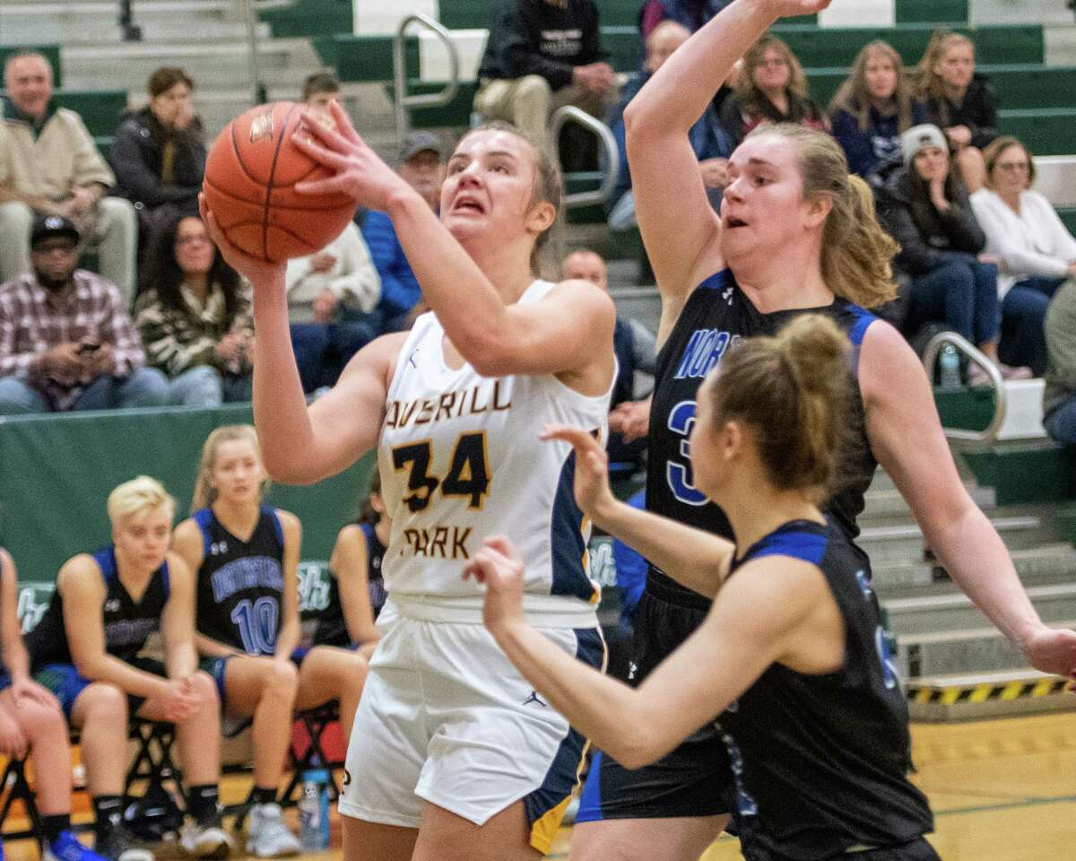 Averill Park senior Kelsey Wood goes up strong in front of two Cicero-North Syracuse defenders during a game at Shenendehowa High School on Sunday, Dec. 8, 2019 (Jim Franco/Special to the times Union.)