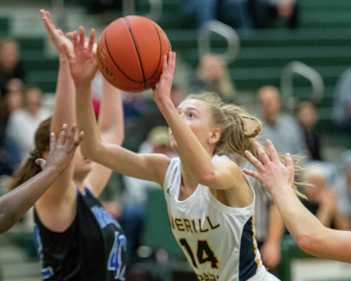 Averill Park junior Julia Gelder keeps her eye on the basket in the middle of Cicero-North Syracuse defenders during a game at Shenendehowa High School on Sunday, Dec. 8, 2019 (Jim Franco/Special to the times Union.)