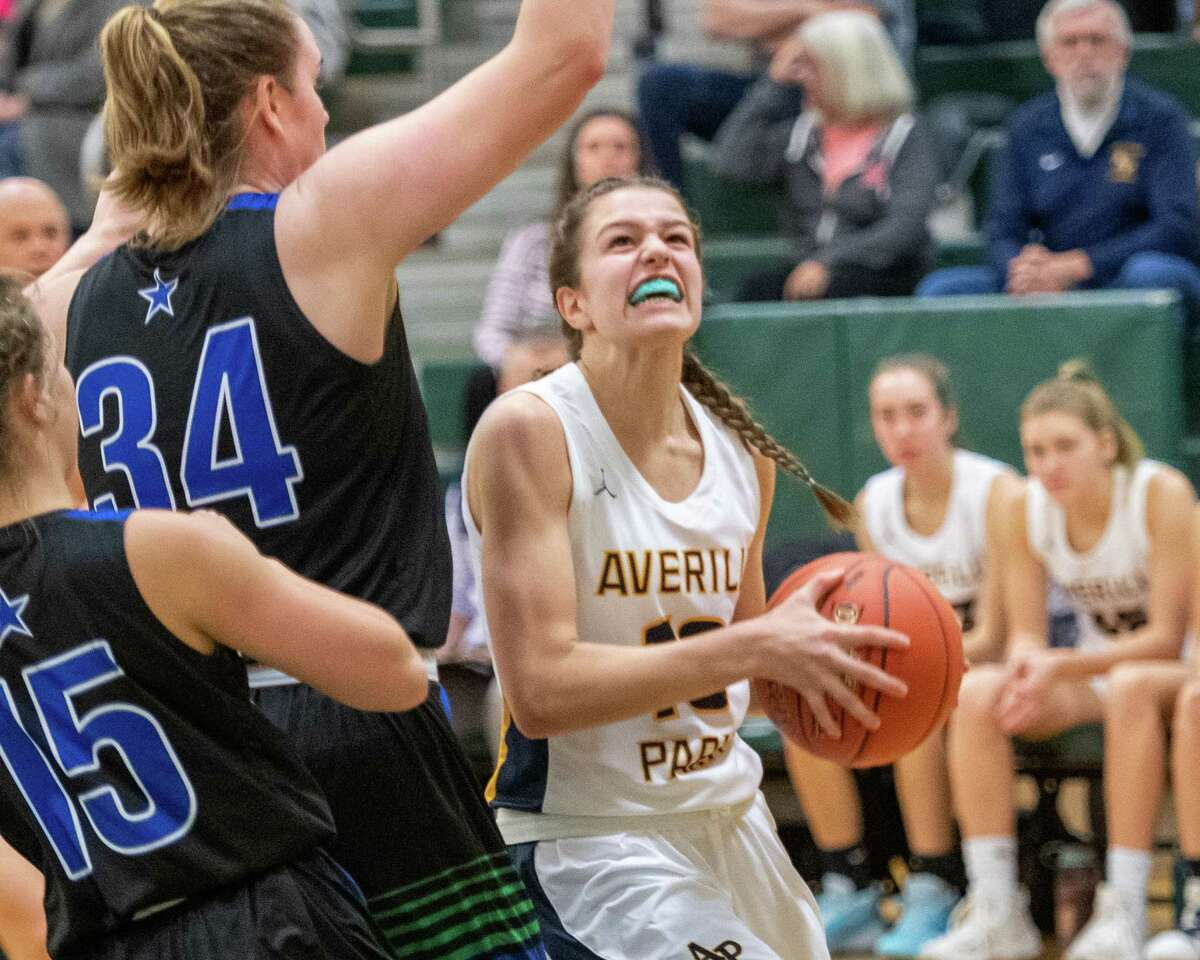 Averill Park junior Anna Jankovic goes up strong against Cicero-North Syracuse junior Jessica Cook during a game at Shenendehowa High School on Sunday, Dec. 8, 2019 (Jim Franco/Special to the times Union.)