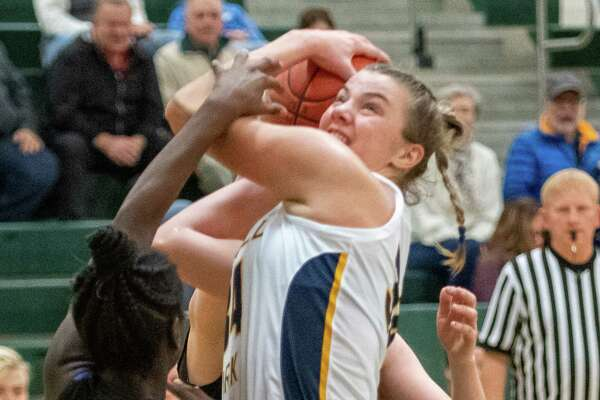 Averill Park senior Kelsey Wood draws a foul against Cicero-North Syracuse sophomore Alita Carey-Santalgelo during a game at Shenendehowa High School on Sunday, Dec. 8, 2019 (Jim Franco/Special to the times Union.)
