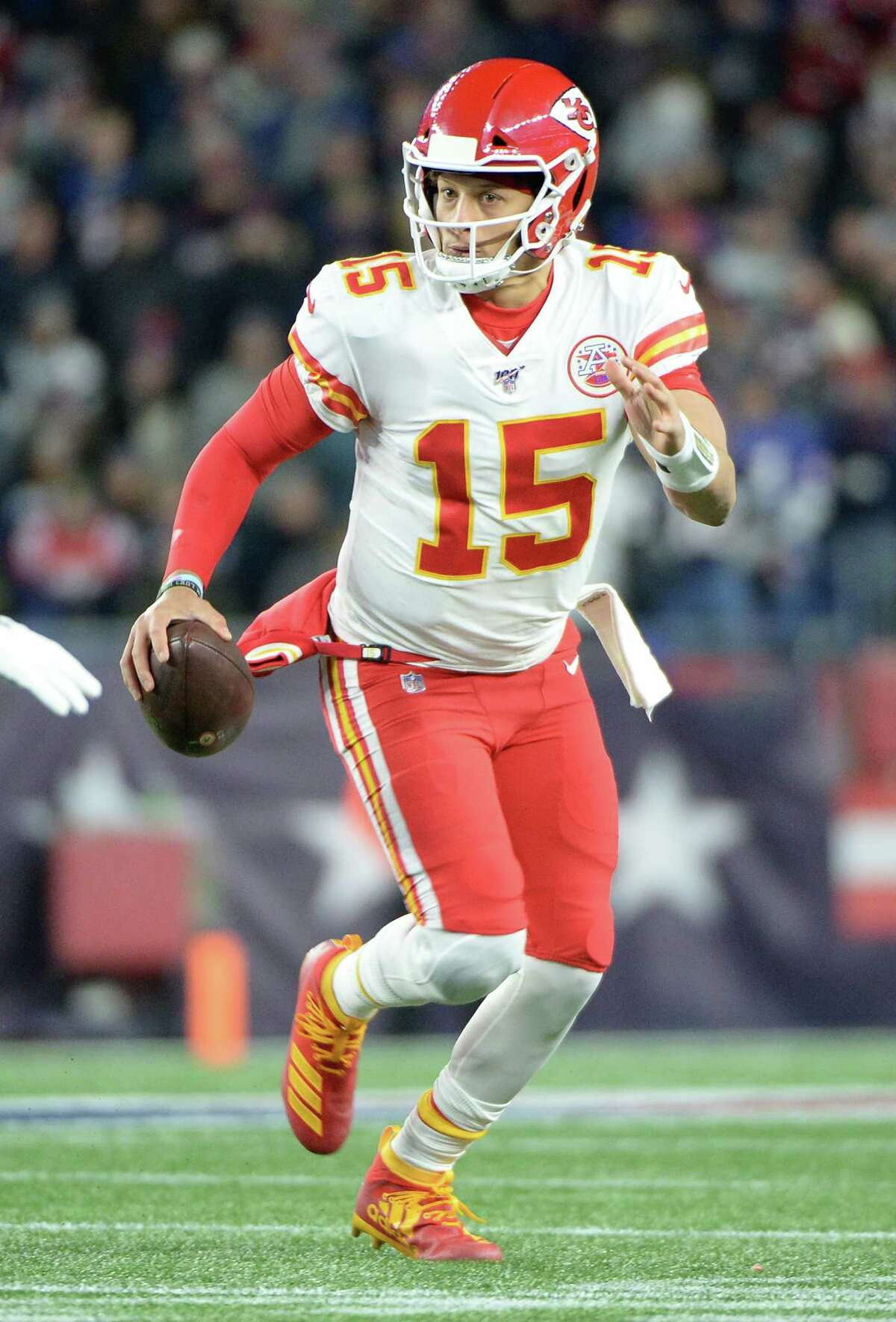 FOXBOROUGH, MASSACHUSETTS - DECEMBER 08: Patrick Mahomes #15 of the Kansas City Chiefs scrambles during the first half against the New England Patriots in the game at Gillette Stadium on December 08, 2019 in Foxborough, Massachusetts. (Photo by Kathryn Riley/Getty Images)
