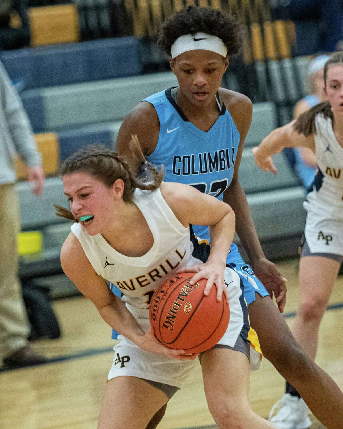 Averill Park forward Anna Jankovic grabs a rebound in front of Columbia forward Lauren Filien during the Averill Park Tip Off Tournament at Averill Park High School on Friday, Nov. 29, 2019 (Jim Franco/Special to the Times Union.)