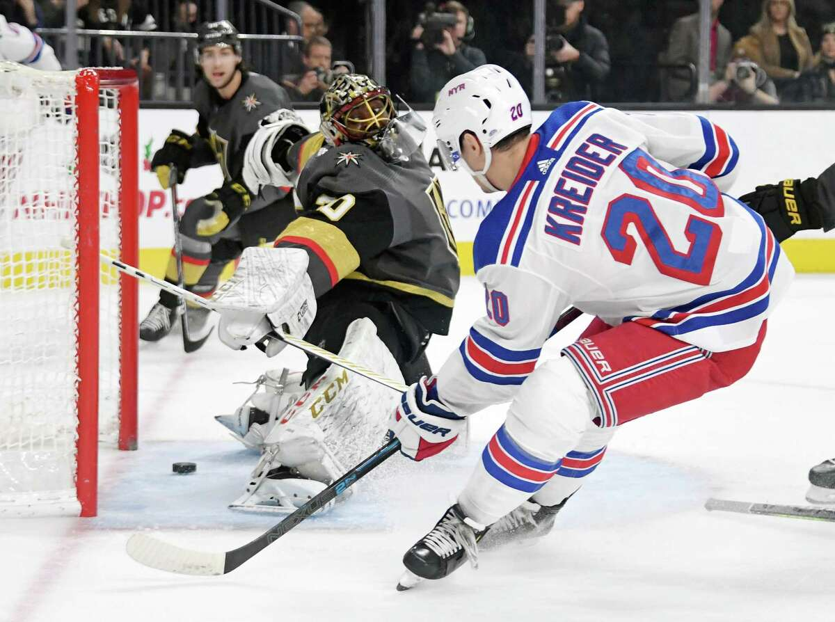 LAS VEGAS, NEVADA - DECEMBER 08: Chris Kreider #20 of the New York Rangers scores a first-period goal against Malcolm Subban #30 of the Vegas Golden Knights during their game at T-Mobile Arena on December 8, 2019 in Las Vegas, Nevada. (Photo by Ethan Miller/Getty Images)