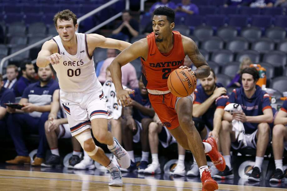 Dayton guard Ibi Watson (2) drives to the basket past Saint Mary's guard Tanner Krebs (00) during the first half of an NCAA college basketball game, Sunday, Dec. 8, 2019, in Phoenix. (AP Photo/Ralph Freso) Photo: Ralph Freso / Associated Press