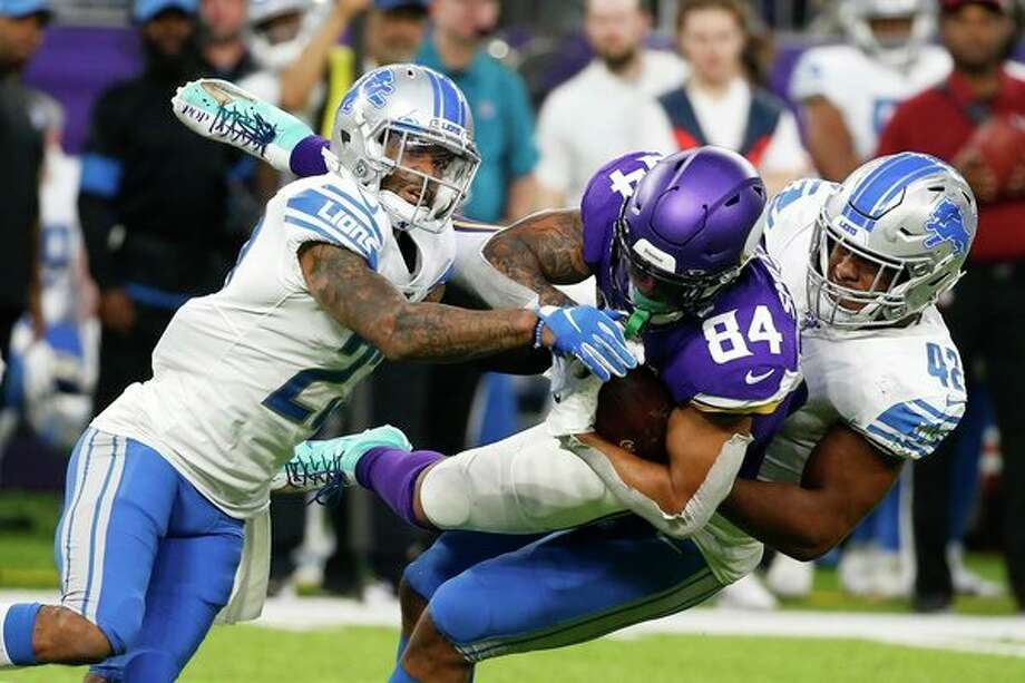 Minnesota Vikings tight end Irv Smith (84) is tackled by Detroit Lions defenders Darius Slay, left, and Devon Kennard, right, after catching a pass during the second half of an NFL football game, Sunday, Dec. 8, 2019, in Minneapolis. (AP Photo/Bruce Kluckhohn) / Copyright 2019 The Associated Press. All rights reserved