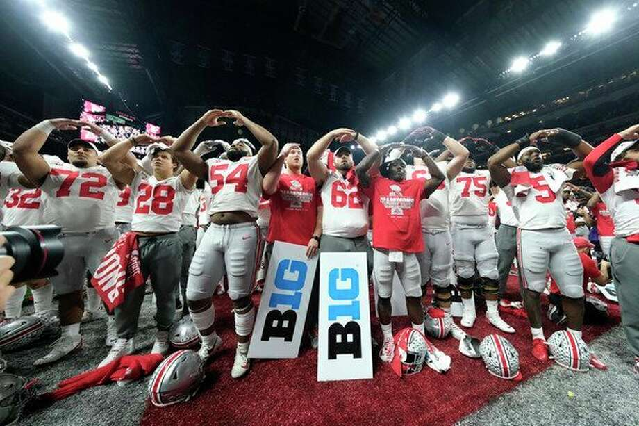 Ohio State players celebrate the team's 34-21 win over Wisconsin in the Big Ten championship NCAA college football game, early Sunday, Dec. 8, 2019, in Indianapolis. (AP Photo/AJ Mast) / Copyright 2019 The Associated Press. All rights reserved.
