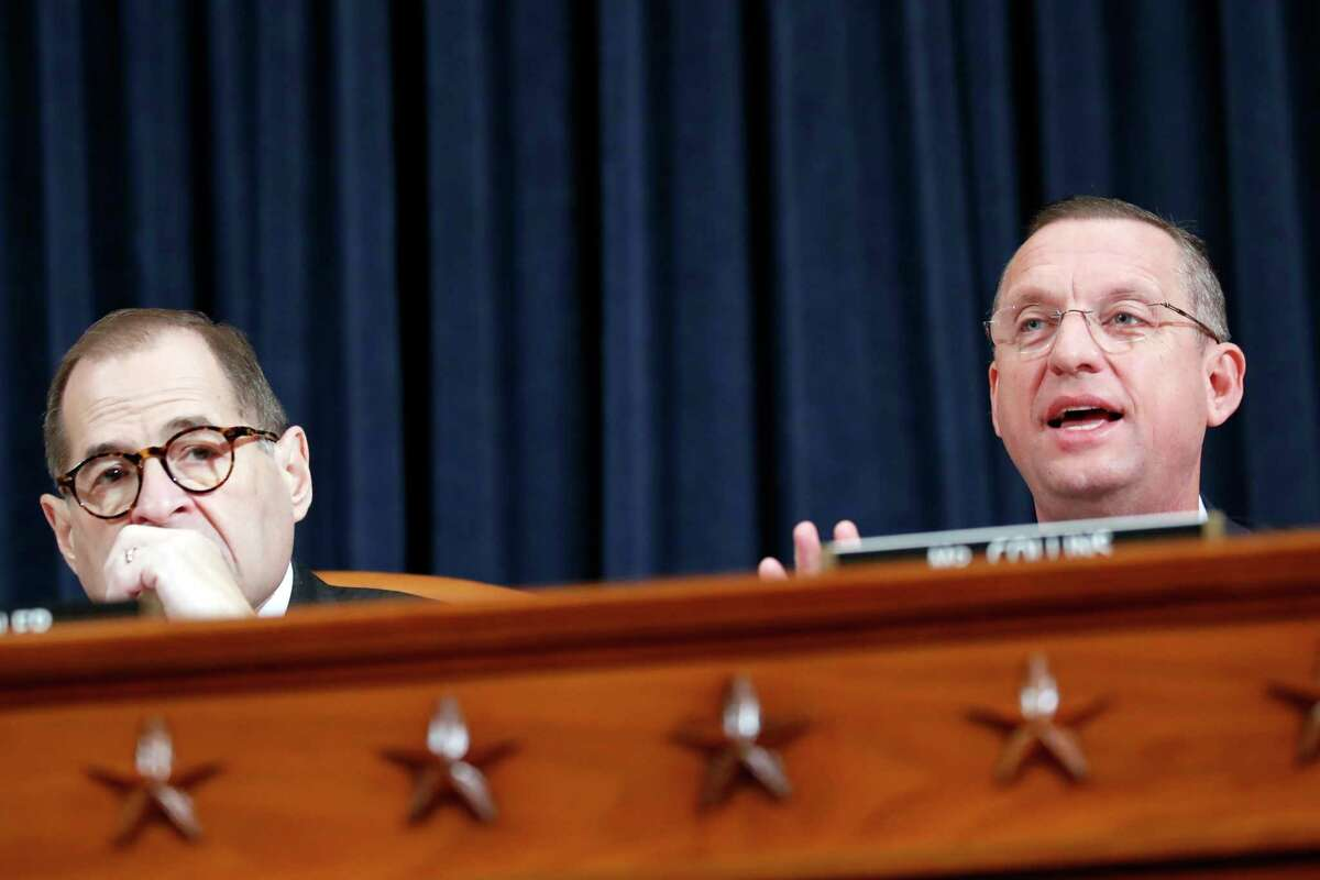 House Judiciary Committee Chairman Rep. Jerrold Nadler, D-N.Y., left, listens as ranking member Rep. Doug Collins, R-Ga., gives and opening statement as the House Judiciary Committee hears investigative findings in the impeachment inquiry of President Donald Trump, Monday, Dec. 9, 2019, on Capitol Hill in Washington.