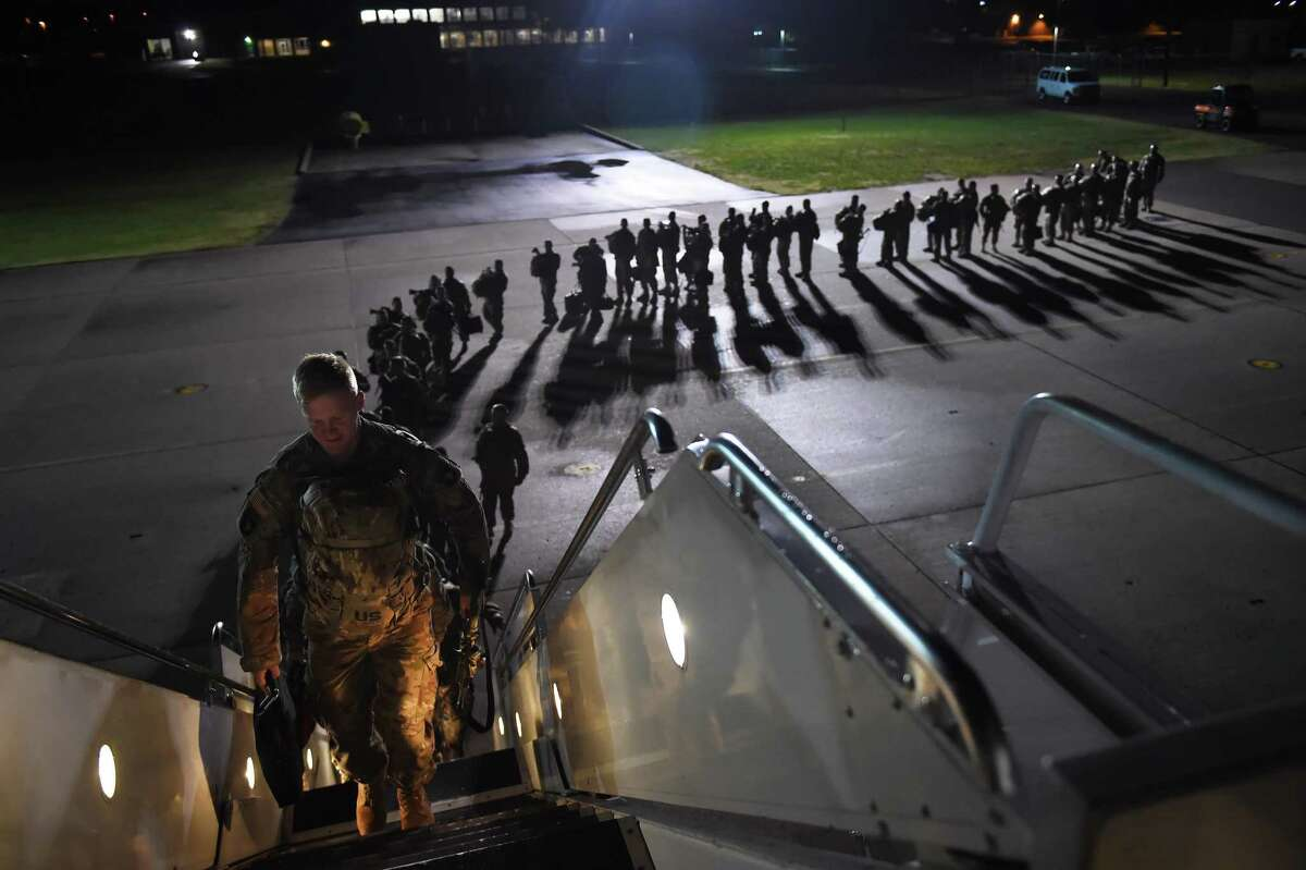 U.S. Army personnel board a plane for a deployment to Afghanistan from Fort Campbell, Ky., on Nov. 6, 2014.