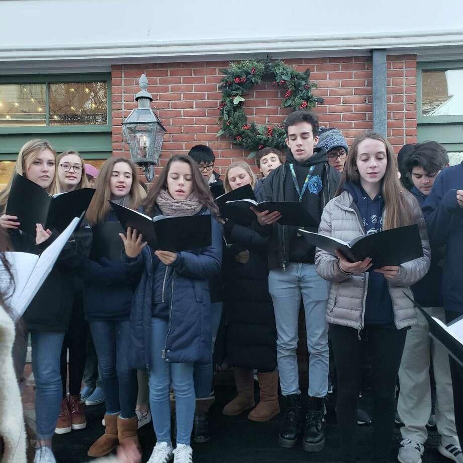 The Darien High School Tudor Singers performed. Photo: Sandra Diamond Fox / Hearst Connecticut Media / Connecticut Post