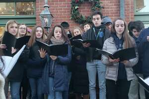 The Darien High School Tudor Singers performed.