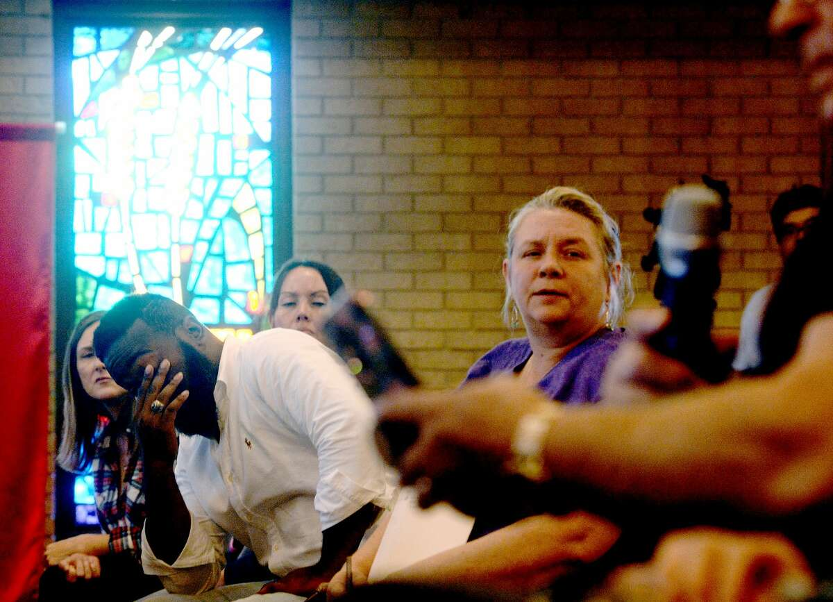 Fred Vernon and Lanay Hebert react as they listen to information offered in regards to TPC Group's explosion and its impact to the environnment, surrounding communities and residents during a town hall meeting hosted by Lone Star Legal Aid at Empowerment Church in Port Arthur Saturday. Photo taken Saturday, December 7, 2019 Kim Brent/The Enterprise