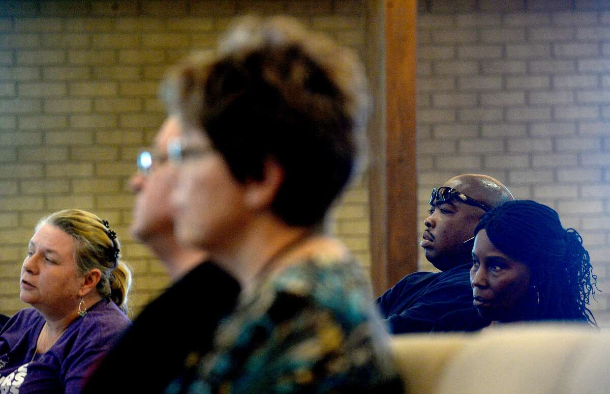Emanuel Foster and his aunt Anita Broussard listen to information offered in regards to TPC Group's explosion and its impact to the environnment, surrounding communities and residents during a town hall meeting hosted by Lone Star Legal Aid at Empowerment Church in Port Arthur Saturday. Photo taken Saturday, December 7, 2019 Kim Brent/The Enterprise