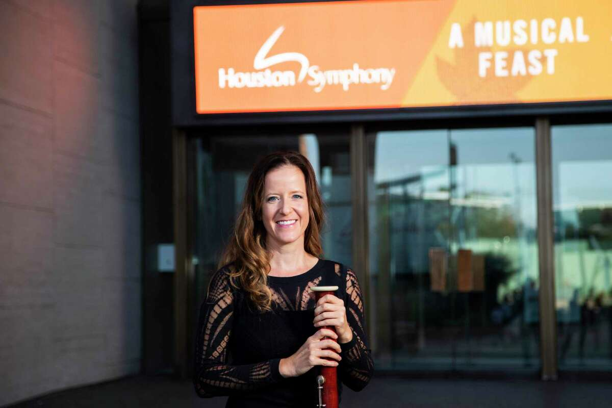 Elise Wagner holds her bassoon by the Jesse H. Jones Hall for the Performing Arts on Wednesday, Nov. 6, 2019, in Houston. Wagner, who is also a runner, has been a member of the Houston Symphony bassoon section since September 2008. Wagner focuses in exercising because it's important for her breathing, and overall core support, which makes her a better musician.