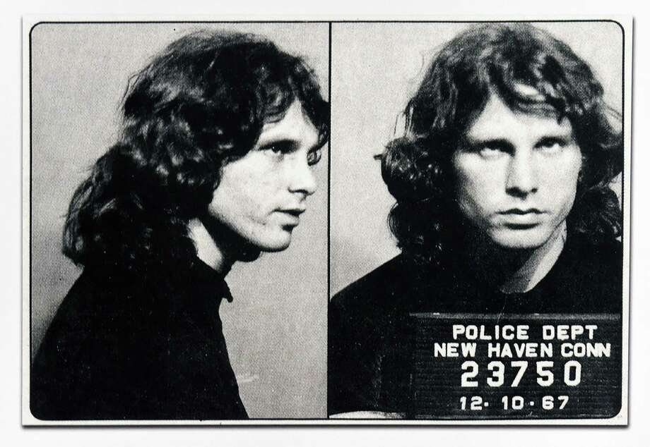 A New Haven Police Department mug shot of Jim Morrison is part of the exhibit, Made in New Haven, An Artist's Collection of Cultural Artifacts Celebrating Civic Pride of Place, by Robert S. Greenberg on the back wall in the Hearing Room in New Haven's Hall of Records photographed on 9/27/2016. Photo: Arnold Gold / Hearst Connecticut Media File Photo