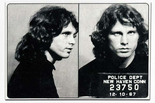 A New Haven Police Department mug shot of Jim Morrison is part of the exhibit, Made in New Haven, An Artist's Collection of Cultural Artifacts Celebrating Civic Pride of Place, by Robert S. Greenberg on the back wall in the Hearing Room in New Haven's Hall of Records photographed on 9/27/2016.
