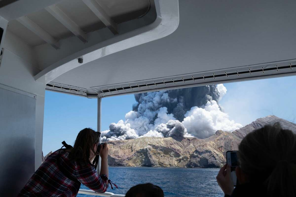 Choking gray ash shot up into the air when a volcano on New Zealand's White Island erupted on Dec. 9, 2019. Michael Schade who images and shared them on his Twitter account @sch. He noted this image was taken one to two minutes into the eruption.