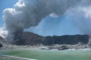 Choking gray ash shot up into the air when a volcano on New Zealand's White Island erupted onDec. 9, 2019. MichaelSchadewho images and shared them on his Twitter account @sch. He noted this image was taken one to two minutes intothe eruption.