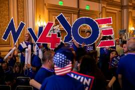 """Joe Biden supporters arrive before the Nevada State Democratic Party's """"First In The West"""" event in Las Vegas, on Sunday, Nov. 17, 2019. The 2020 Democrats headed West to campaign in two key states as Nevada will be the third state to vote next year, with its caucus coming just 11 days after the New Hampshire primary and voters in California will start casting early ballots in the Democratic primary soon after the Iowa caucuses begin. (Joe Buglewicz/The New York Times)"""