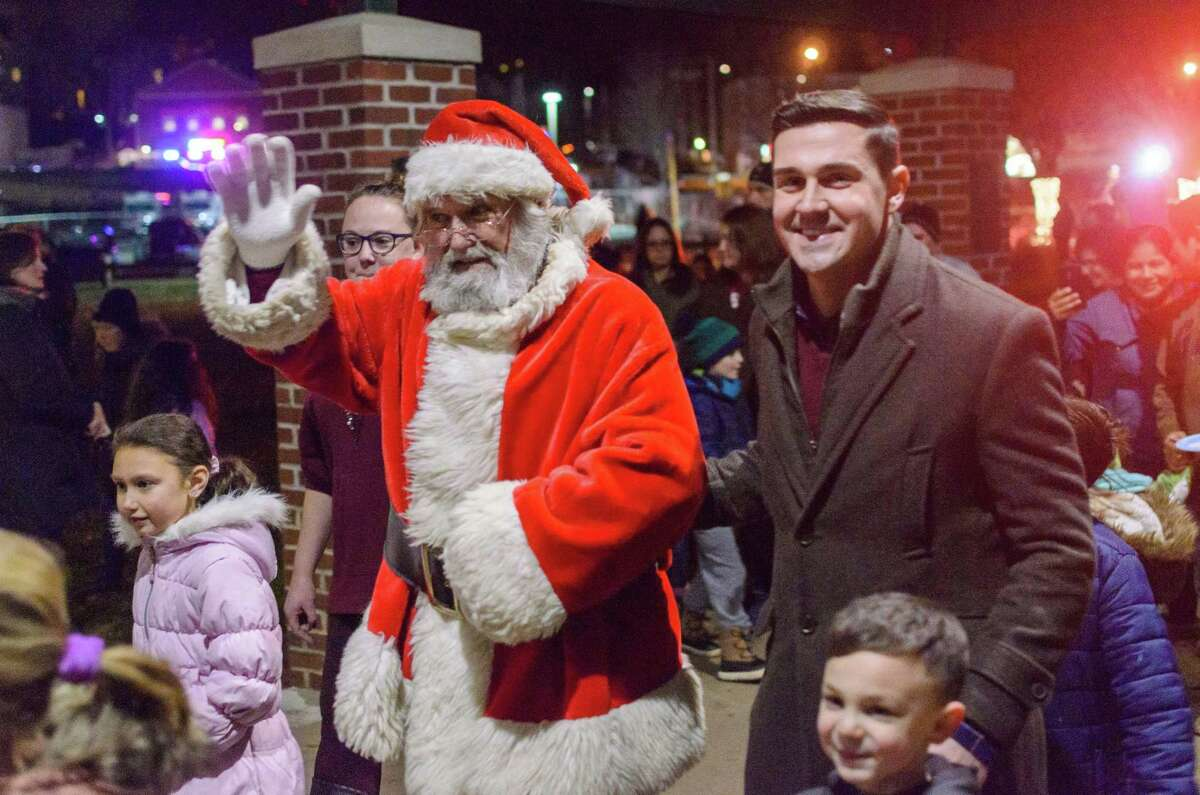 Santa Claud was greeted by Jimmy Tickey, right, at the Celebrate Shelton's annual tree lighting in 2019. This year's tree lighting will be Friday, Dec. 4, at 6:30 p.m. at the Rotary Pavilion at Veteran's Memorial Park.