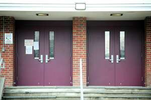 The secured front doors of Dolan Middle School on Toms Road in Stamford, Conn. on Thursday, Feb. 15, 2018.