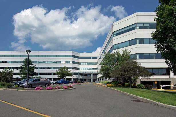 The RiverPark office building at 800 Connecticut Ave. in Norwalk, Conn., where Booking Holdings has its headquarters alongside subsidiary Priceline. (Photo courtesy CBRE)