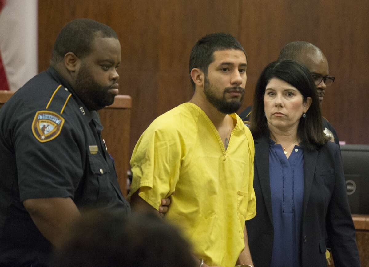Arturo Solis, 25, is taken away with no bond after appeared to Judge Danilo Lacayo at the 182nd Judicial District Court at Harris County Criminal Justice Center on Monday, Dec. 9, 2019, in Houston. Solis is accused of shooting and killing Houston Police Department Sgt. Christopher Brewster on Saturday.