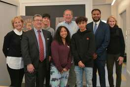 Future 5 Founding Partner Polly Perkins Johnson; Bankwell SVP Rob Mallozzi; Future 5 students Selin Agurcia and Jada Maradiaga; Future 5 Founder Clif McFeely; Future 5 Student Angel Vargas; Bankwell Branch Manager Brian Sahai and Future 5 Director of Development Diane Knetzger.