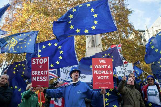 Anti-Brexit campaigners protest outside the Houses of Parliament in London on Nov. 19, 2018.