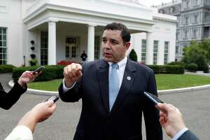 FILE - In this Sept. 13, 2017 file photo, Rep. Henry Cuellar, D-Texas, speaks with reporters outside the West Wing after a bipartisan meeting with President Donald Trump at the White House. (AP Photo/Alex Brandon, File)