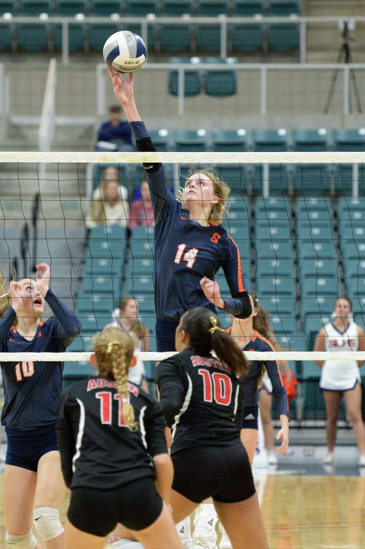 Ally Batenhorst (14) of Seven Lakes hits a shot during the second set of a Class 6A Region III bi-district volleyball playoff match between the Seven Lakes Spartans and the Ft. Bend Austin Bulldogs on Tuesday, November 5, 2019 at the Leonard Merrell Center, Katy, TX.