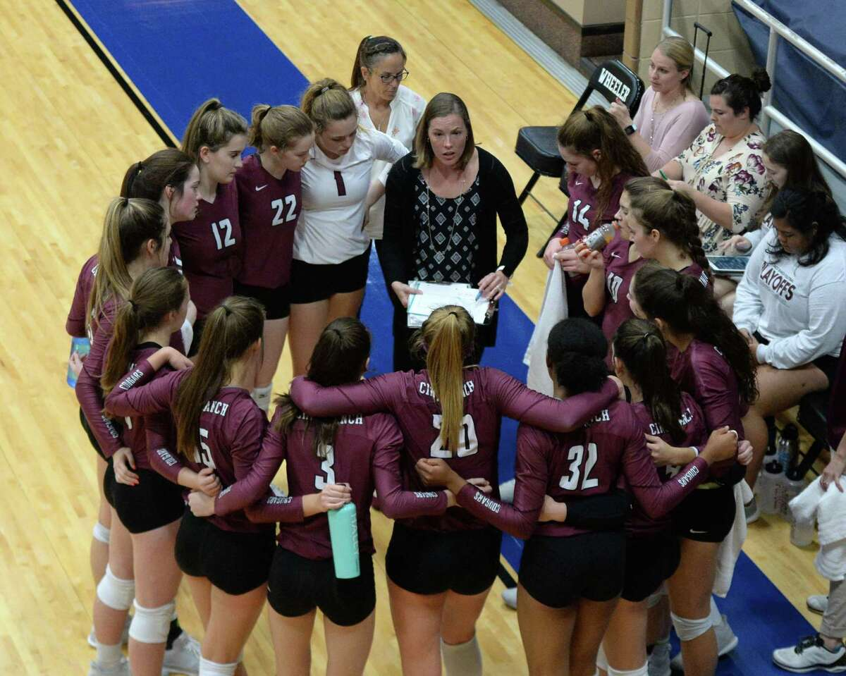 Cinco Ranh Head Coach Danielle Wells talks to the Cougars before the second set of a bi-district playoff volleyball match between the Cinco Ranch Cougars and the Travis Tigers on October 30, 2018 at Wheeler Fieldhouse, Sugar Land, TX.