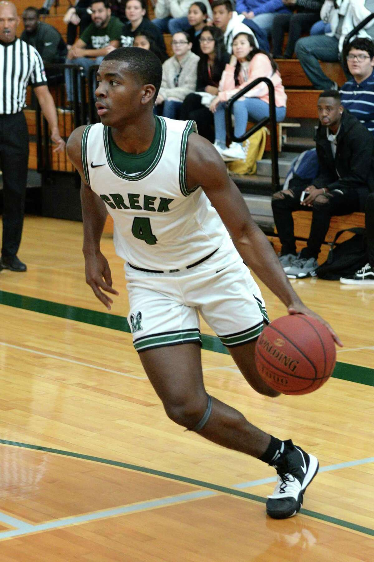 Rommell Williams (4) of Mayde Creek drives toward the paint during pool play of the Katy Classic Basketball Tournament between the Mayde Creek Rams and the Tomball Cougars on Thursday, December 5, 2019 at Mayde Creek HS, Houston, TX.